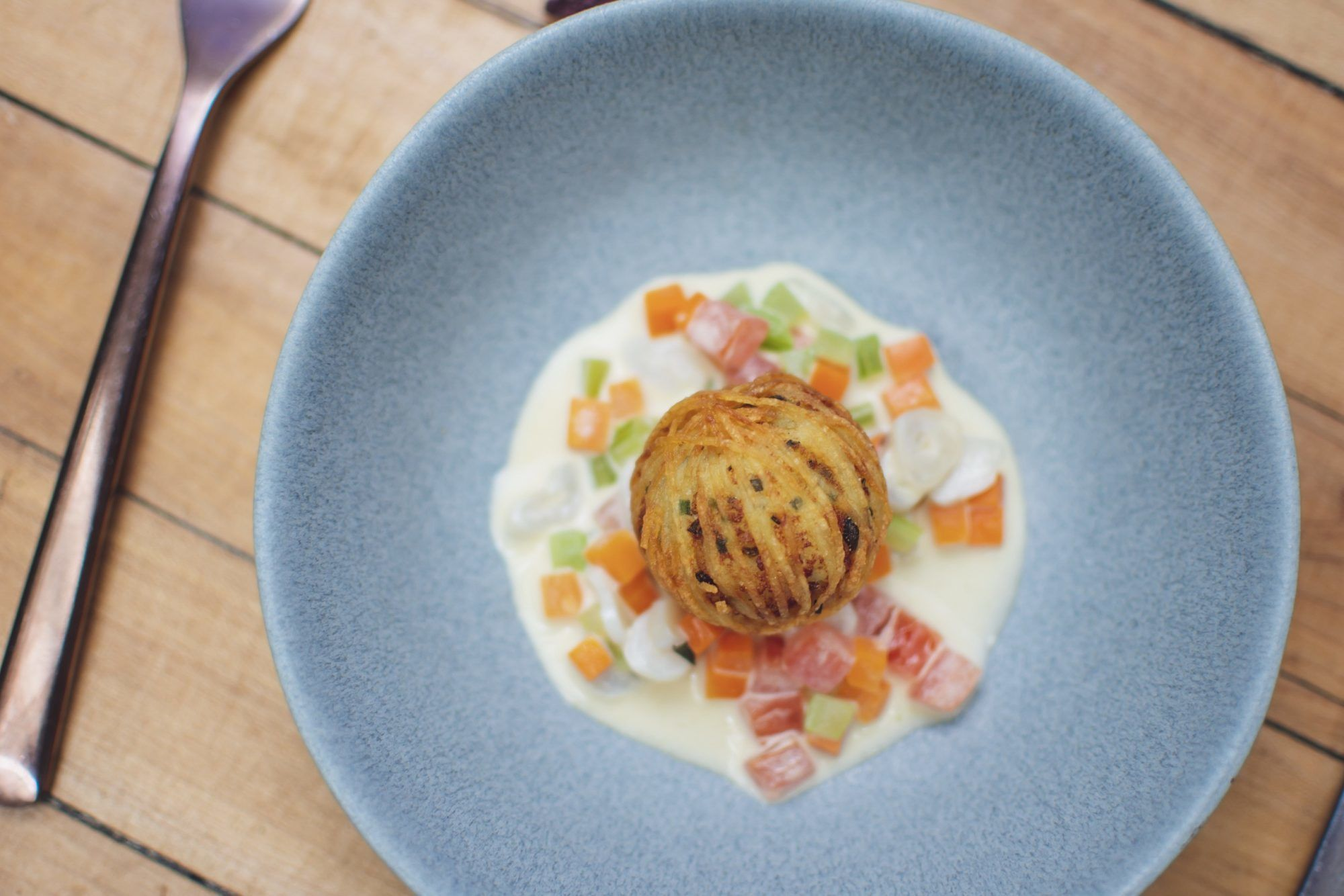 Clam chowder with smoked haddock fishcake